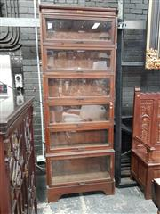 Sale 8868 - Lot 1016 - Early 20th Century Australian Oak Stacking Legal Bookcase by Butterworth, of six sections with one larger, all with glass panel door...