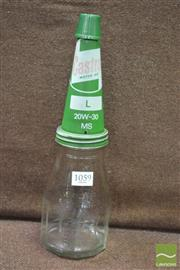 Sale 8338 - Lot 1059 - Castrol Oil Bottle with Tin Funnel and Plastic Cap