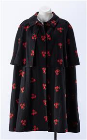 Sale 8910F - Lot 68 - A vintage Saint Laurent, Paris rive gauche Iverness cape in black wool with floral embroidery, approx size M/L