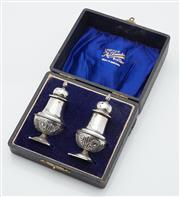 Sale 9085S - Lot 27 - A pair of George V Sterling Silver peperettes, hallmarked Birmingham 1912 and housed in makers presentation box marked A. Saunders o.