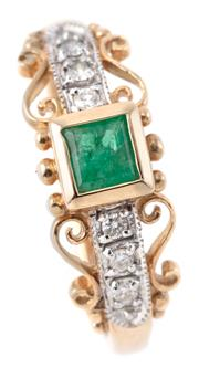 Sale 9095 - Lot 385 - A 9CT GOLD EMERALD AND DIAMOND RING; rub set with a square cut emerald between shoulders each set with 3 round brilliant cut diamond...