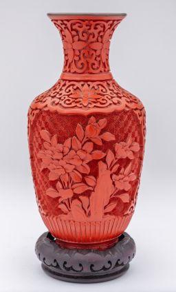 Sale 9150J - Lot 31 - A good vintage carved cinnabar vase, the scroll carved body framing floral decoration to both sides, the interior in blue enamel, ra...