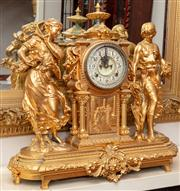 Sale 8804A - Lot 45 - An impressive late Victorian Ansonia gilt brass mantel clock, dated 1881 with a painted dial and visible escapement in an architectu...