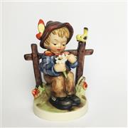 Sale 8456B - Lot 46 - Hummel Figure of a Boy She Loves Me Not