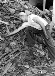 Sale 8721A - Lot 14 - Artist Unknown - Scrap Metal Worker, 1961 30 x 22cm