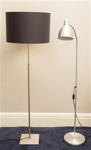 Sale 8741A - Lot 88 - A brushed steel height extendable standard lamp on square form base with back fabric shade together with an Ikea example
