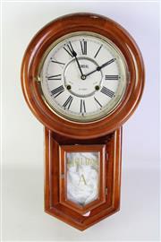 Sale 8905S - Lot 613 - A timber regulator 31 day wall clock. Length 55cm