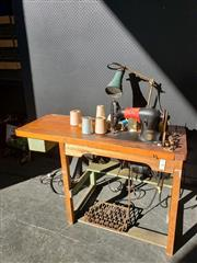 Sale 9026 - Lot 1042 - Industrial Singer Sewing Machine On Timber Stand With Original Lamp Attached & Contents (H105cm)