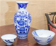 Sale 8550H - Lot 65 - A Chinese blue and white baluster vase with lobed body and foliate decoration, H 31cm together with a blue and white damaged bowl, D...