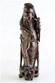 Sale 8852 - Lot 71 - A Carved Timber Chinese Immortal Figure (H 37cm)