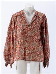 Sale 8910F - Lot 76 - A vintage Saint Laurent, Paris rive gauche floral printed peasants blouse (minor holes to back), size 42