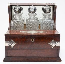 Sale 9150J - Lot 23 - An antique oak nickel bound 3 bottle English tantalus C: 1900. The tantalus with 3 original good condition matching bottles in a nic...
