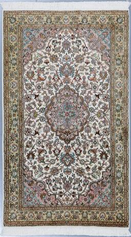 Sale 9199J - Lot 84 - A pure silk finely knotted Kashmir rug, with central medallion design, soft mellow colour combination, 158cm x 94cm