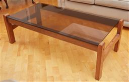 Sale 9098H - Lot 43 - A contemporary and smoky glass coffee table, Height 41cm x Width 127cm x Depth 62cm