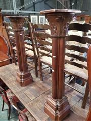Sale 9031 - Lot 1071 - Pair of Late 19th/ Early 20th Century Walnut Ecclesiastical pedestals, the capitals with leaves, on quatrefoil section columns  & cr...