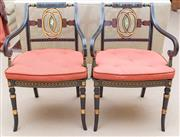 Sale 8550H - Lot 63 - A pair of Regency style ebonised and gilt elbow chairs with  cane seats, painted with gold, green, red and swan motif with removable...
