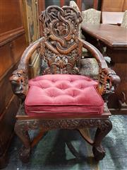 Sale 8774 - Lot 1015 - Japanese Meiji Heavily Carved Armchair, the pierced back and arms with intertwining dragons & shishi below, raised on cabriole legs