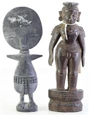 Sale 8985 - Lot 19 - A carved Indian figure (H22.5cm) together with a Nigerian disc head figure (H21.5cm)