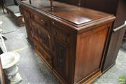 Sale 8317 - Lot 1079 - Edwardian Carved Walnut Sideboard with two drawers & doors, flanked by larger doors