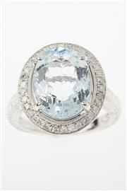 Sale 8299J - Lot 318 - AN 18CT WHITE GOLD AQUAMARINE AND DIAMOND DRESS RING; featuring an oval cut light blue aquamarine of approx. 4.64ct surrounded by 34...