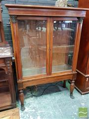 Sale 8485 - Lot 1050 - Empire Style Mahogany Vitrine, with two glass panel doors with attached columns, raised on caved legs with paw feet