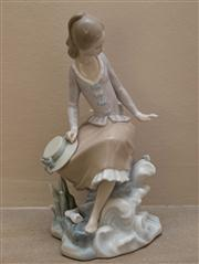 Sale 8313A - Lot 14 - A Lladro figure of a young lady with a hat resting on a rock, H-21My