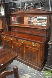 Sale 8317 - Lot 1030 - Late Victorian Carved Walnut Sideboard, with low mirror back & long shelf, two drawers & three panel doors, enclosing a cellarette d...