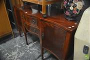 Sale 8317 - Lot 1070 - Georgian Style Mahogany Serpentine Front Sideboard, with two drawers & two panel doors, on tapering legs with spade feet