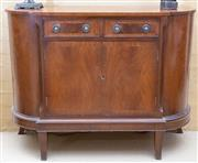 Sale 8550H - Lot 84 - A reproduction Regency style mahogany veneered side board of diminutive size, with two drawers above two cupboard doors, raised on f...