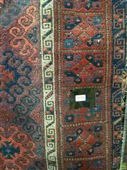 Sale 8634 - Lot 1018 - Antique Probably Balouch Wool Carpet, with off-set hooked guls, in dark red tones
