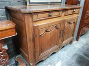 Sale 8868 - Lot 1143 - Early 19th Century French Oak Buffet, with two drawers & two shaped panel doors (Key in Office)
