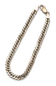 Sale 9012 - Lot 346 - A 9CT GOLD DOUBLE CURB LINK BRACELET; 5.15mm wide links to a parrot clasp, length 19cm, wt.14.05g.