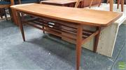 Sale 8395 - Lot 1029 - Elevated Teak Coffee Table with Raised Lip Ends & Shelf Below