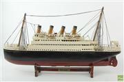 Sale 8591 - Lot 7 - Titanic Wooden Model Ship (L:56cm H:29cm)