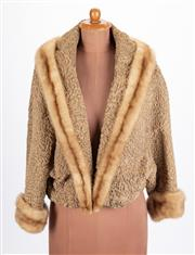 Sale 8640F - Lot 98 - A silk linked Astrakhan fur jacket with mink trim
