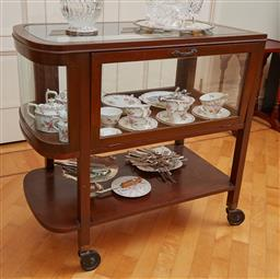 Sale 9098H - Lot 48 - A vintage mahogany bow ended tea trolley/ drinks cart with glass top and surround with low shelf and raised on castors, Height 83cm...