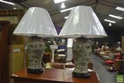 Sale 8350L - Lot 52 - A pair of hand painted polychrome urn lamps with cream shades on timber bases, total H 63cm, RRP $ 850