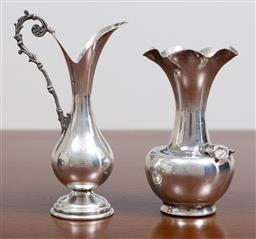 Sale 9140H - Lot 73 - Two small silver items including a jug and a bud vase, height of taller 10.5cm, combined weight 87g