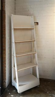 Sale 8734A - Lot 8 - A free-standing timber Bookshelf/Display Stand on castors, h. 203cm, w. 67cm, base depth 44cm