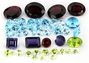 Sale 8790 - Lot 322 - A PARCEL OF UNSET GEMSTONES; blue topaz, wt. 7.81ct, peridots wt. 2.45ct, garnets 9.80ct, iolite, 1.75ct.
