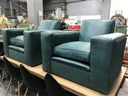 Sale 8822 - Lot 1247 - Pair of Green Vinyl Club Chairs