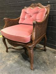 Sale 9048 - Lot 1050 - French Carved Walnut Bergere, with cane back, sides & seat having loose pink cushions, raised on cabriole legs with stretcher base (...