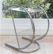 Sale 9066H - Lot 54 - A deco style chrome and glass occasional table with built in magazine rack. H 62cm.