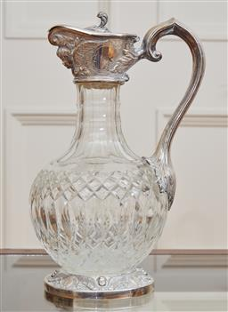 Sale 9098H - Lot 49 - A silver plated cut glass wine ewer with masked spout and cherub decoration to foot, Height 28cm