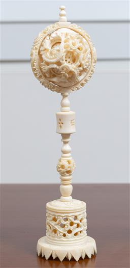 Sale 9140H - Lot 27 - An intricately carved ivory puzzle ball on stand, Height 24cm