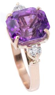 Sale 8982 - Lot 346 - AN AMETHYST AND TWO DIAMOND RING; set in 9ct rose gold with an octagonal cut amethyst (10 x 9.4mm), flanked by 2 round brilliant cut...