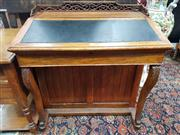 Sale 8939 - Lot 1077 - Unusually Wide Victorian Oak Davenport Desk, with pierced gallery back, black leather hinged top, on cabriole legs. H: 89, W: 86, D:...