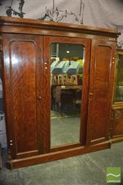 Sale 8402 - Lot 1043 - Victorian Satinwood Wardrobe, with centre mirror & two timber panel doors, enclosing slides & drawers, the cantered corners with car...