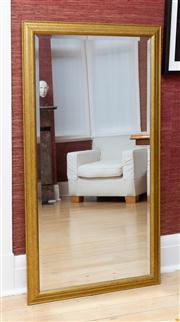 Sale 8741A - Lot 29 - A bevelled edge rectangular mirror in a gilt frame 134cm x 72cm