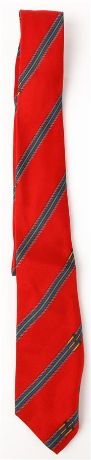 Sale 9080F - Lot 53 - A GUCCI 100% PURE SILK TIE; in red with a green and blue buckle pattern and gucci logo embroided to inside